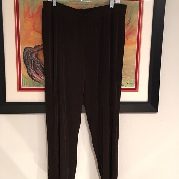 Chico's size 3 travel knit pant - deep brown EUC These Chico's size 3 travel knit pants are a deep chocolate brown, sleek, no pockets, excellent gently used condition. Chico's Pants Straight Leg