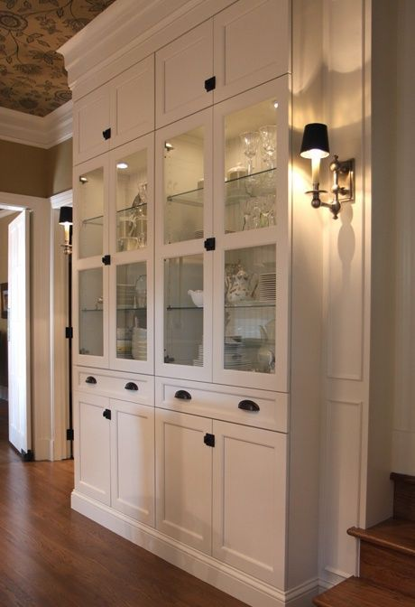 Built-in from Ikea Billy cabinets, add side panels with sconces @ Home Improvement Ideas