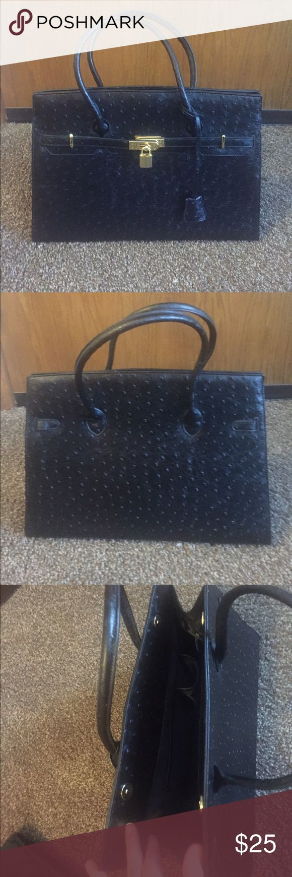 Black ostrich purse Used once. In great condition. Any questions please ask. Bags