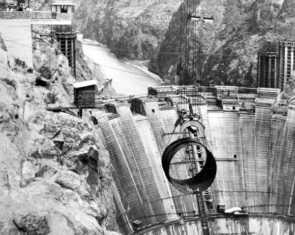 Constructing the Hoover Dam was one of the greatest accomplishments of the 20th Century. 1,244 feet across, 724 feet tall and 660 feet wide at the base, it contained more masonry than the Great Pyramid. And tens of thousands of men descended upon the Mojave desert to build it.