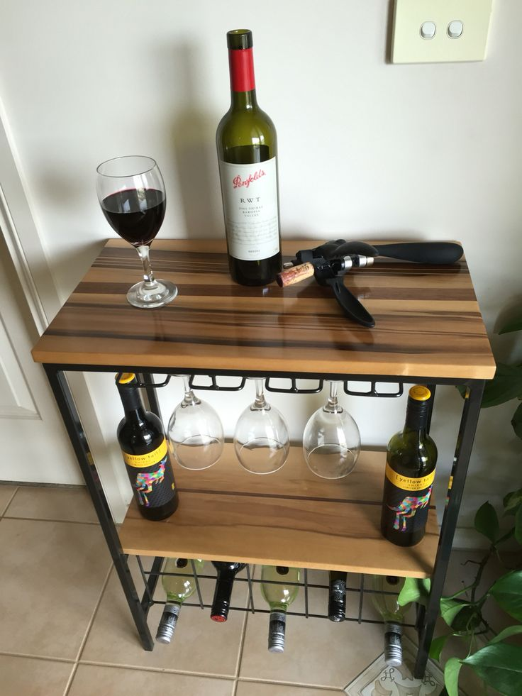Wine stand made from black heart sassafras timber & black metal stand