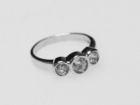 Three Stone Rubover Silver Ring: Timeless sparkles of this classically-shaped ring ensure its great compatibility with any other jewellery box items. $25.00