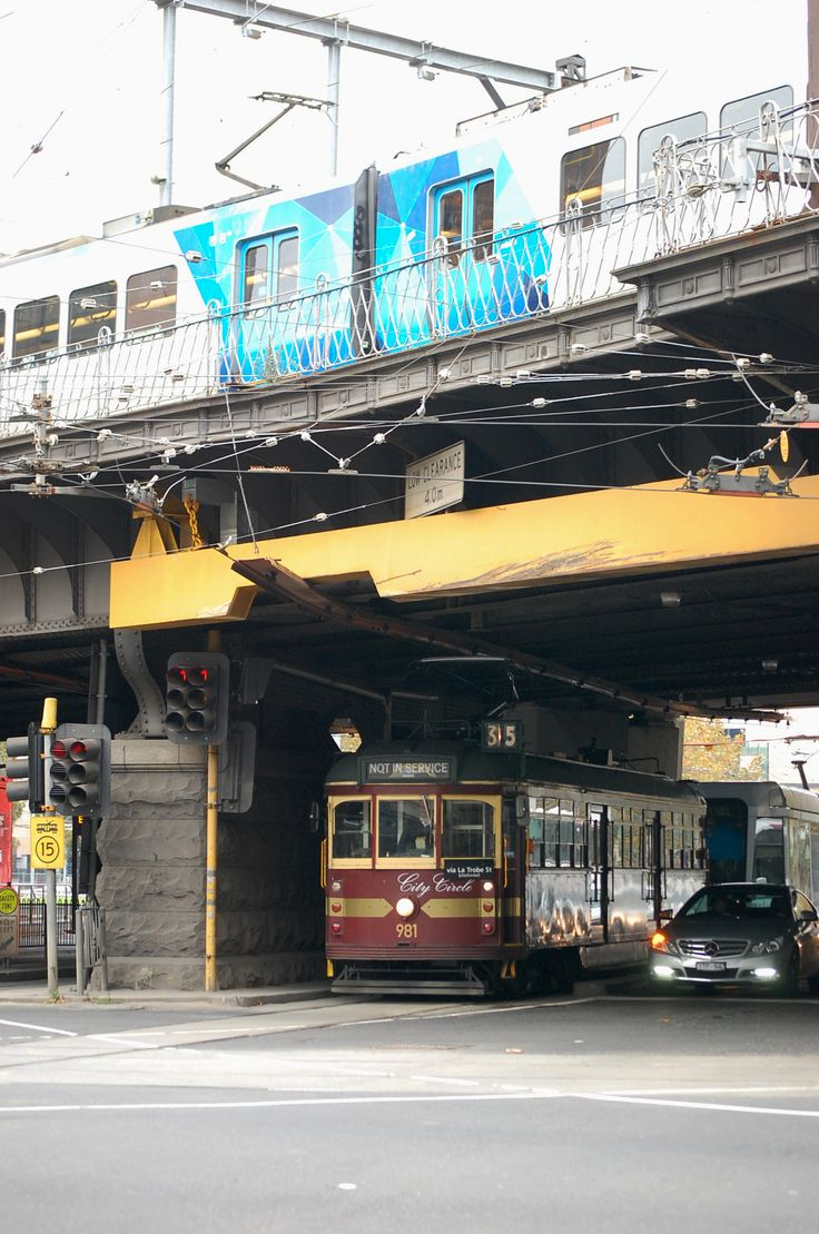 A tram and a train. Corner of Flinders and Spenser Streets, Melbourne