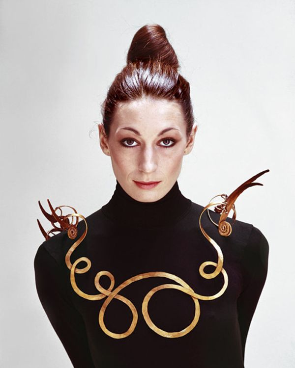 Anjelica Huston wearing Alexander Calders brass necklace