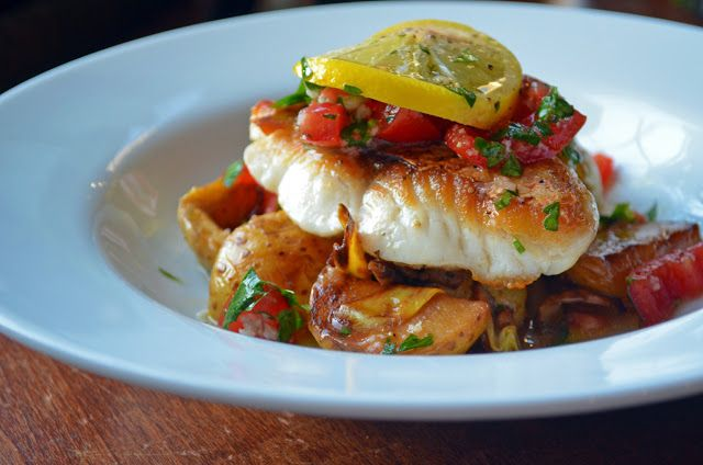 Red Snapper with Baby Potatoes, Wild Mushroom, and Artichoke Ragout with Vierge Sauce.