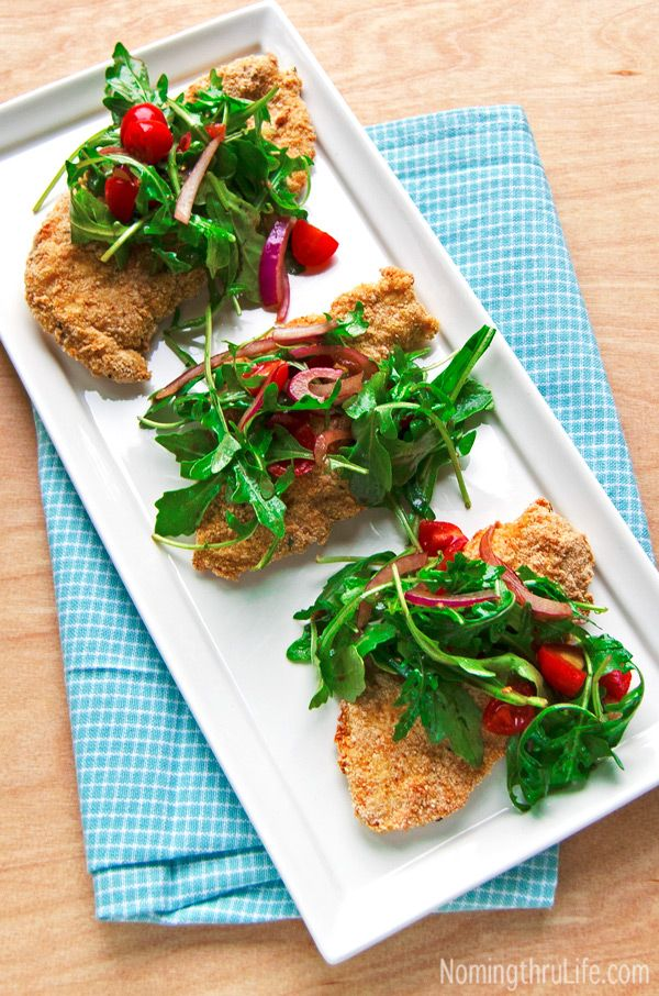 Skinny Chicken Milanese - Baked instead of fried chicken with a simple salad, makes for a deliciously easy and nutritious meal. Recipe @ NomingthruLife.com