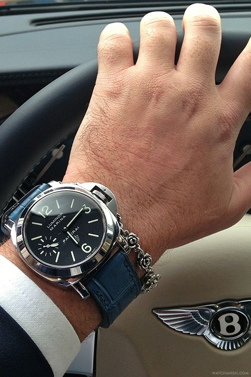 Panerai Luminor Marina 005 on a blue alligator strap from Simona Straps paired with a silver rose motif bracelet