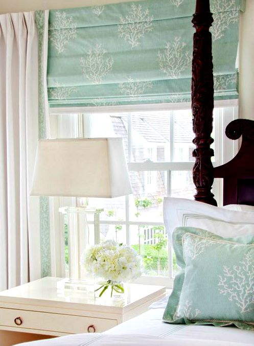 Coastal flair with soft pastel coral motif fabric for roman shades and pillows: http://www.completely-coastal.com/2015/01/seashells-coral-driftwood-on-pedestal-stands.html