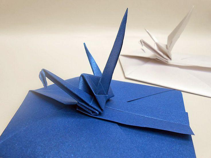 origami - sobres plegados en papel con detalle de grulla