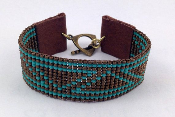 Metallic bronze and turquoise loom beaded bracelet with glass seed beads, leather tabs fastened with a brass toggle clasp