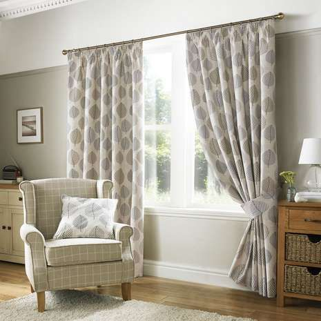 Crafted from 100% cotton with a pencil pleat heading, these fully lined curtains are finished in a natural colour and decorated with a repeated pebble grey leaf...