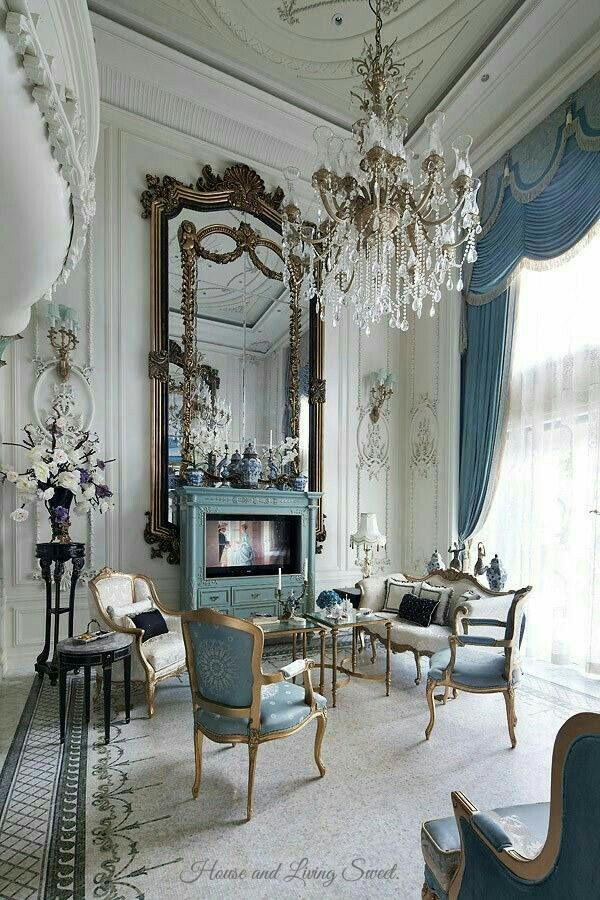 Stunning Drawing Room With High Ceiling, Huge Chandelier And Mirror And  Elegant Furniture.