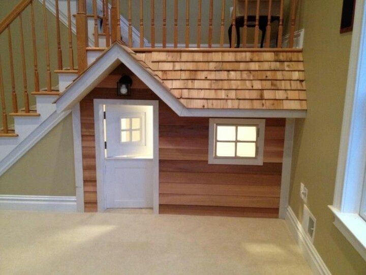 Kids playhouse built-in under basement stairs!