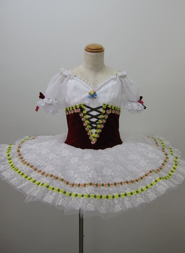 NEW COLLECTION 2015! This professional stage costume is ideal for the role of Swanilda in the ballet Coppelia. It can also be used for other classical variations. The upper part of the costume feature