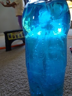 Make a jellyfish in a bottle with an empty plastic bottle, food coloring, clear plastic bag, and some dental floss.  Would look great on the light table.  Could color the water, color the jellyfish, or color both different colors.
