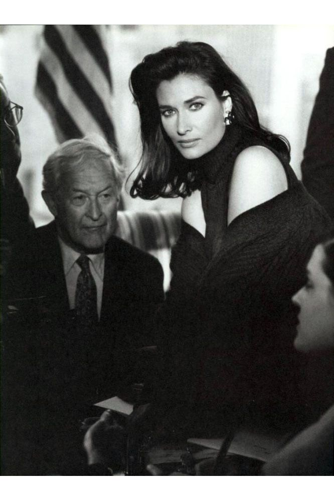 """""""In Women We Trust,"""" which came out in 1992, starred model Rosemary McGrotha as a fictional female president, boarding planes, giving speeches, and hanging out with her infant in a wardrobe of tailored blazers and windswept hair. President McGrotha is sexy enough to wear her blouse unbuttoned, hinting at a glimpse of her bra — and powerful enough that her all-male bodyguard posse pretends not to notice."""