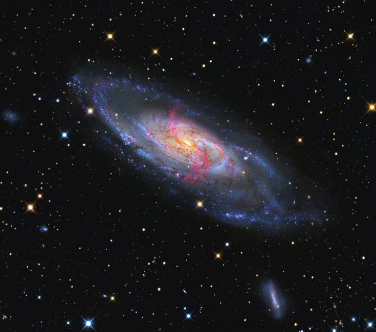 M106 also catalogued as NGC4258 is a spiral galaxy appearing in the constellation Canes Venatici. It is approximately 22 to 25 million light-years away from Earth.
