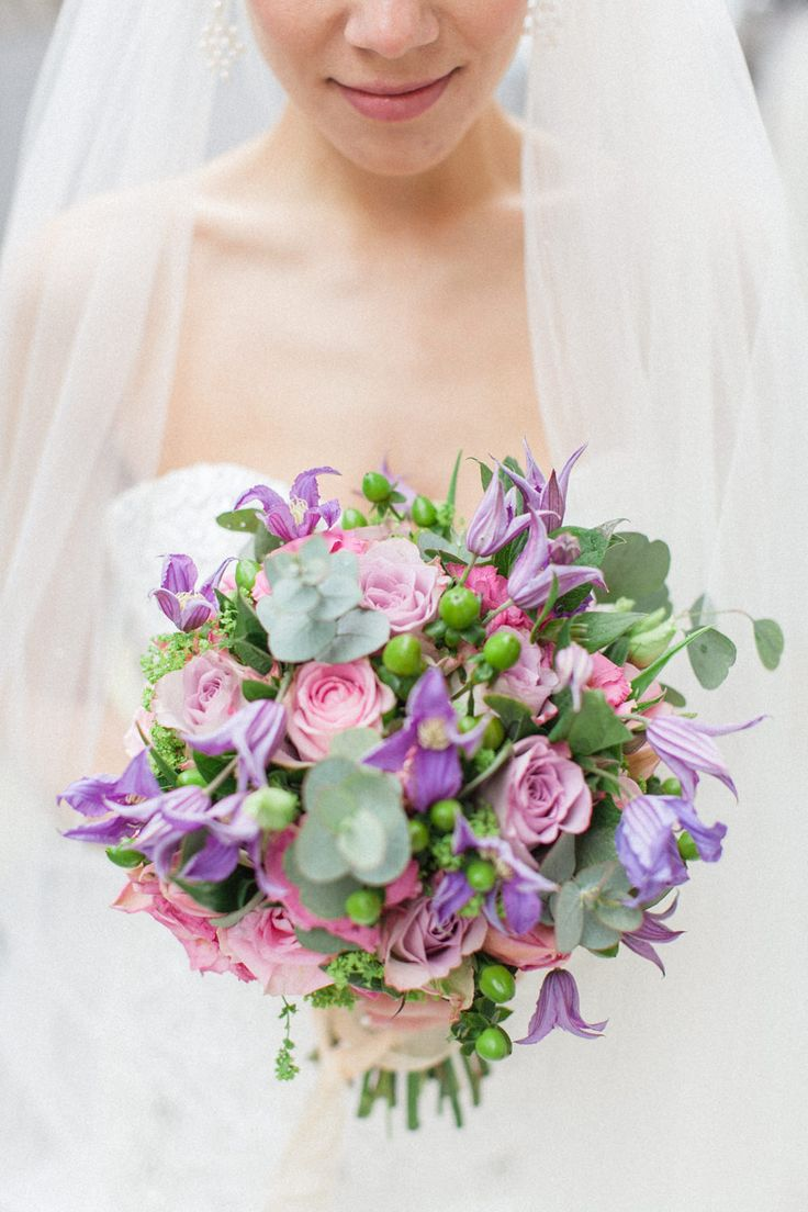 Pink and purple themed bridal bouquet. Luxury wedding inspiration at the Corinthia Hotel in London. Flowers by Amie Bone Flowers. Image by Roberta Facchini.