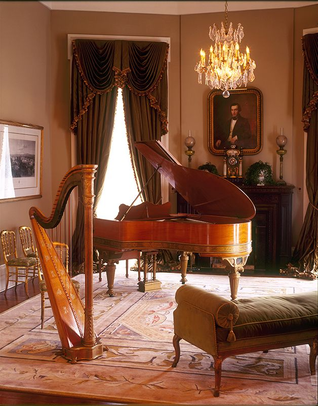 The music room complete with a grand piano and harp.