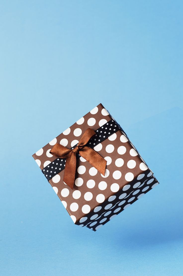 Gift box with dots - Gift box with dots floating in the air over blue background