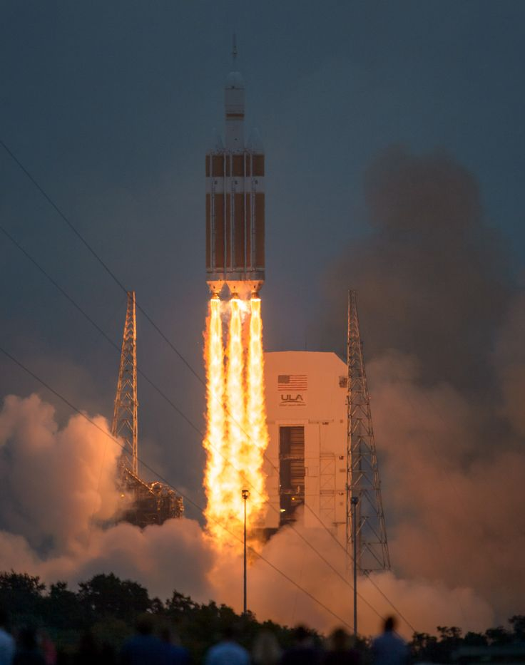 The United Launch Alliance Delta IV Heavy rocket, with NASA's Orion spacecraft mounted atop, lifts off from Cape Canaveral Air Force Station's Space Launch Complex 37 at at 7:05 a.m. EST, Friday, Dec. 5, 2014, in Florida.