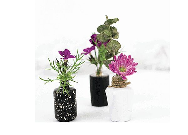 A few clever ways to reuse empty nail polish bottles. (Love those mini vases!)