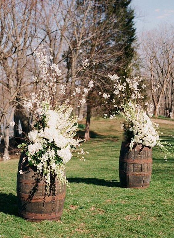 rustic wine barrels and white flowers wedding alter Photo by Holly Chapple Flowers / http://www.himisspuff.com/rustic-country-wine-barrel-wedding-ideas/5/