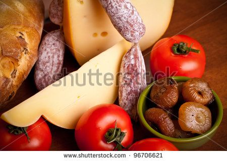 Closeup of mediterranean appetizers: cheese, sausages,grilled onions and tomatoes.#foodphotos #stockphotos #healthyfood #foodingredients #ItalianFood #Shutterstock #bio #naturalfood #eatingwell #slowfood