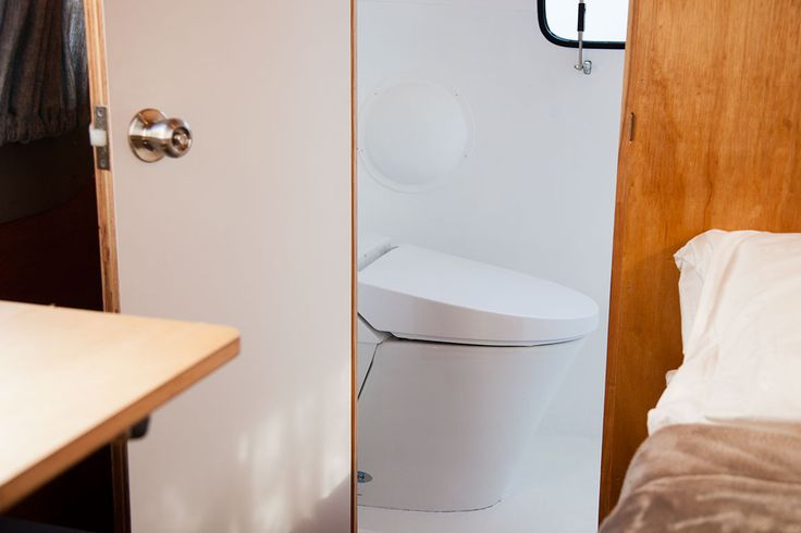 bathroom with modern toilet and shower.