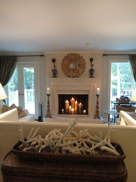 Traditional Living Room With Gorgeous Fireplace Candles Decoration Also  White Elegant Fire Surround And Mantelpiece Also Luxury Sun Shaped Mirror  And ...