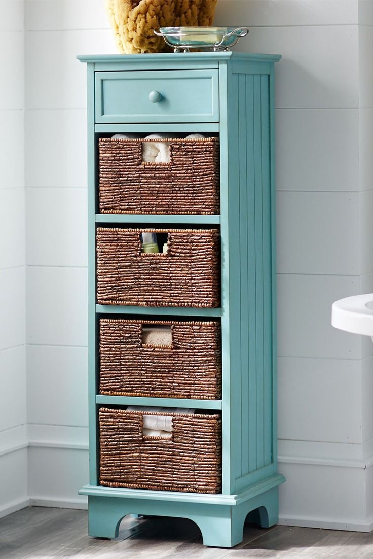 Storage doesn't have to be stark. Pier 1's Holtom Tall Antique Sky Blue Cabinet features a vibrant finish, four hand-woven banana leaf baskets and a drawer for a refreshing way to organize towels, washcloths, lotions and those attachments you never use for your hair dryer.