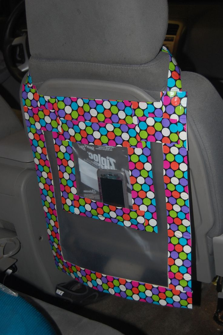 I got this idea from a cloth version of a car organizer for kids.  I used a two gallon size Ziploc bag, a one quart Ziploc bag, and duct tape!