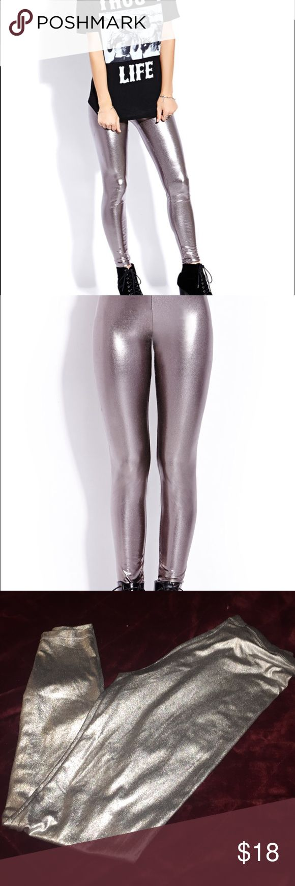 Silver leggings Forever 21 These are so fabulous.. these are a silver legging from Forever 21.. they're a metallic silver, perfect for New Years Eve parties.. you will look gorgeous.. great condition Forever 21 Pants Leggings