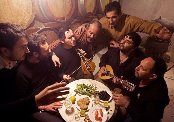 A local group of friends who sing serenades about life and drink Raki