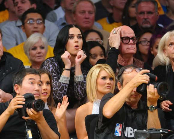 Katy attended a basketball game game with her dad Keith Hudson