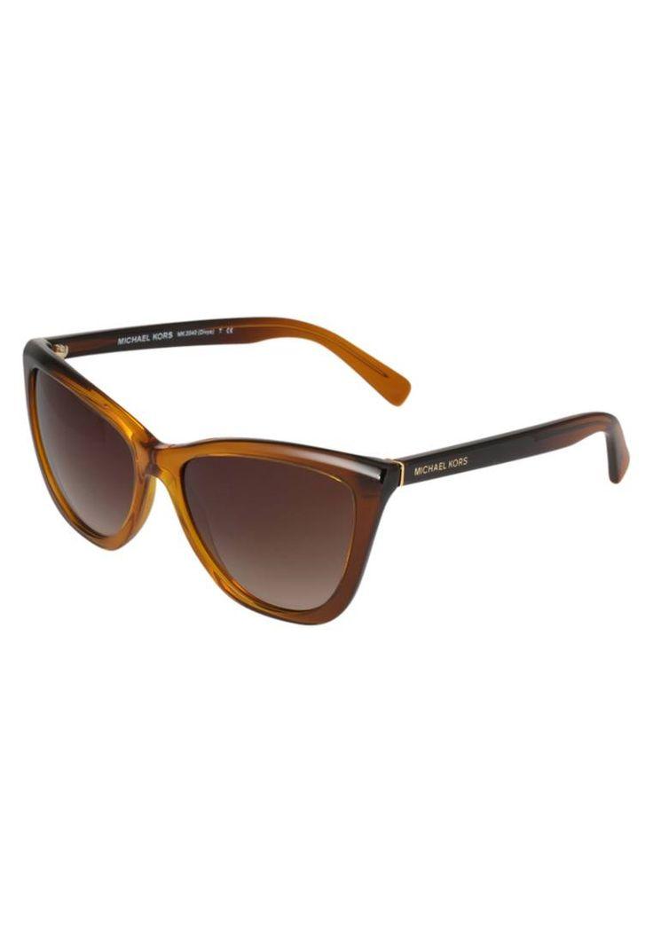 Michael Kors. Lunettes de soleil - honey. Forme des lunettes:papillon. Étui à lunettes:Étui rigide. largeur:13.5 cm en taille 57. Longueur des branches:13.5 cm en taille 57. Filtre UV:oui. Largeur du pont:1.7 cm en taille 57