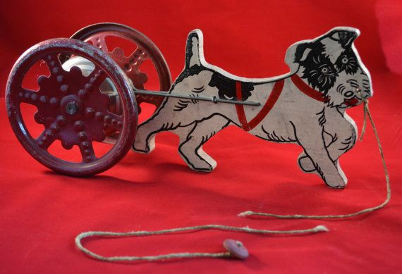 Hey, I found this really awesome Etsy listing at https://www.etsy.com/listing/253390437/vintage-wood-pull-toy-dog-pull-toy