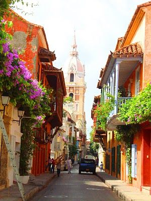 Cartagena. Love the vibrancy. Want to lounge on of their balconies.