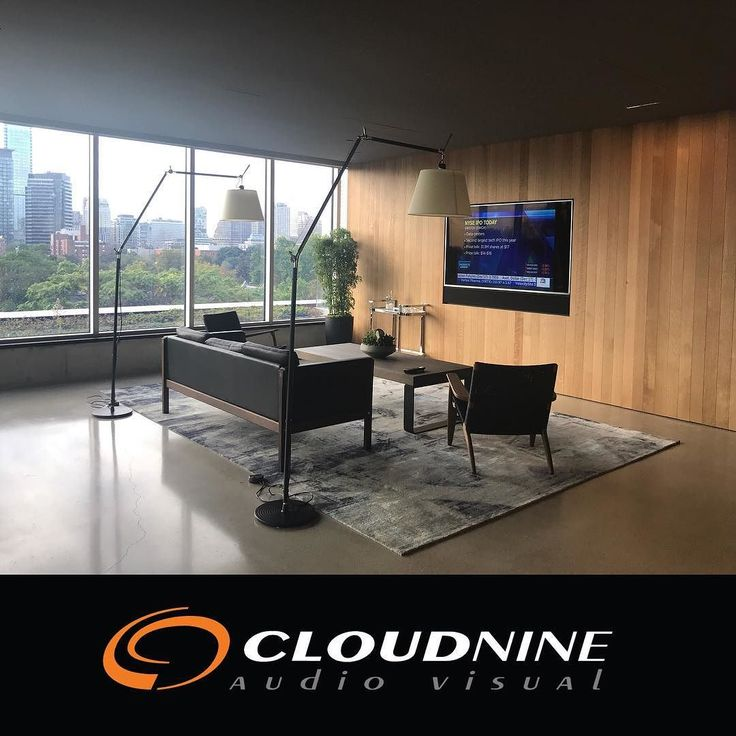 This office lounge is the perfect place to grab a coffee or keep tabs on the market news. For those who burn the midnight oil they can catch the Leafs games on the 75 SAMSUNG. Surround sound powered by @sonos #playbar behind the custom grille.  #officeaudiovisual  #commercialaudiovisual  #smartoffice  #mediaroom #officelounge #goleafsgo @samsungcanada  #samsung75  #sonos