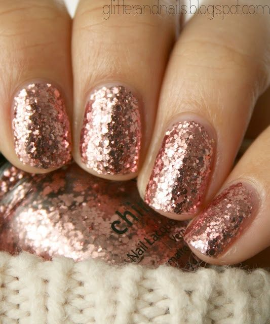 Rose Gold Sparkle - China Glaze Glam Man thats cute but sparkles not fun to get off. Heres a tip. 1.) take nail polish remover on a cotton ball 2.) stick on finger 3.) take small pieces of foil 4.) wrap around nail 5.) push on tightly but gently 6.) wait 3-5 minutes  7.) then push gently down on the nail and swipe off.  This should help get the sparkly nail polish off easier. :)