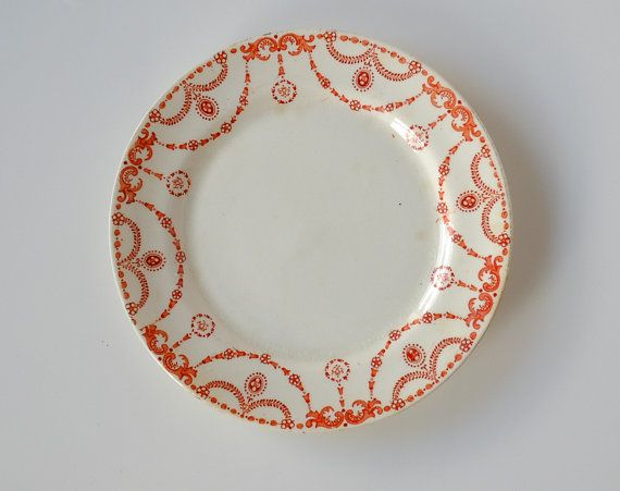 This is a really unusual little piece of Dublin and Irish history. This red ornately-designed transferware plate is a piece of Tuscan China from England