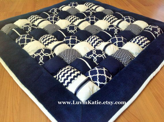 This soft navy blue and white bubble puff quilt is made from premium quality fabrics. It is elegant and sweet - perfect for your little one! It is
