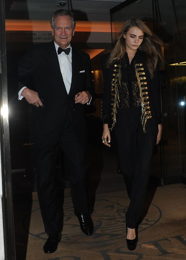 Cara Delevingne with her father Charles Delevingne at Christie's auction house in Mayfair, London, on February 10, 2014
