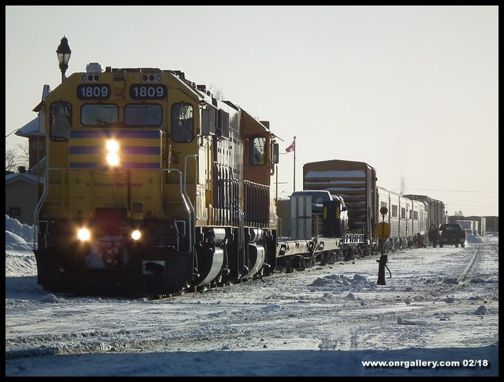 Ontario Northland's 421 Polar Bear receives some last minute repairs a few coaches back by Shops staff at Cochrane before departing north to Moosonee February 6th.