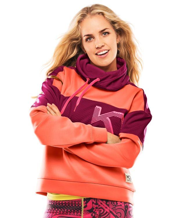 Kari Traa RøtheKari Traa Røthe-genseren er både funky og varm, perfekt på kjølige høstdager. De behagelige og hurtigtørkende materialene har fireveis stretch for total bevegelsesfrihet. Den regulerbare høye kragen er god å pakke seg inn i. Rene linjer kombinert med sterke farger gir en sporty, men urban look.
