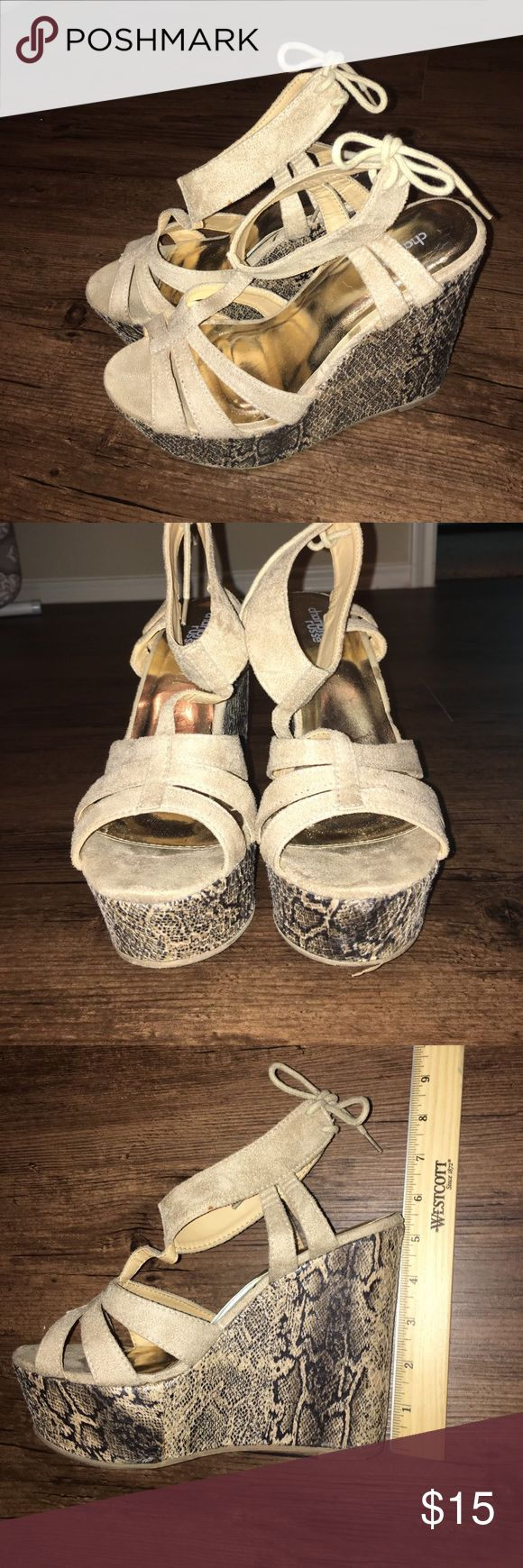 Charlotte Russe Faix Suede Tan Snake Skin Wedges Tan Snake skin Wedges. Faux Suede. Super comfy. Only wear & tear is located on the soles. Other than that they're in great condition! Charlotte Russe Shoes Wedges