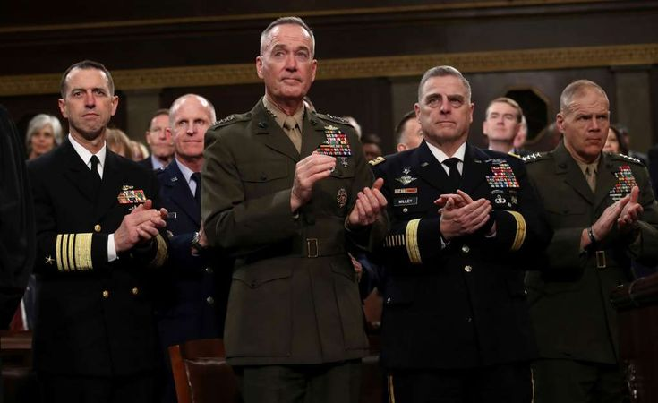 Analysts say Trump comments bad news for North Korea - January 31, 2018.  Chief of Naval Operations Adm. John Richardson, from left, Chairman of the Joint Chiefs of Staff Gen. Joseph Dunford, Chief of Staff of the Army Gen. Mark Milley, and Commandant of the Marine Corps Gen. Robert Neller attend President Trump's State of the Union address on Tuesday.