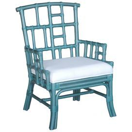 """With an Asian-inspired lattice design and turquoise finish, this teak arm chair brings exotic appeal to your living room or den.     Product: Chair  Construction Material: Teak wood and fabric  Color: Turquoise and white    Dimensions: 37"""" H x 23"""" W x 26"""" D        Care Instructions: Remove dust with a soft, lint-free cloth"""