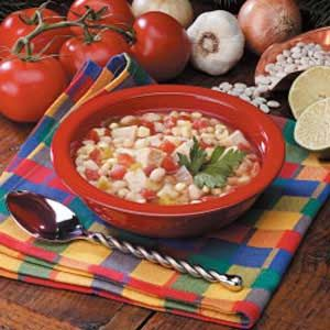 Chicken Soup with Beans Recipe -I put lime-flavored tortilla chips at the bottom of individual bowls before ladling in this Southwestern soup. Loaded with chicken, beans, corn, tomatoes and green chilies, it's satisfying and fuss-free.                                 -Penny Peronia                                  West Memphis, Arkansas