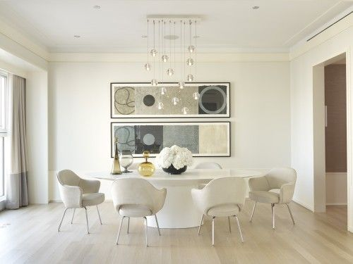 Wow....love!  Table: UFO Oval Table by Emmemobili  Dining Chairs: Saarinen Executive Arm Chair by Knoll  Chandelier: Bocci 14 Pendant Chandelier